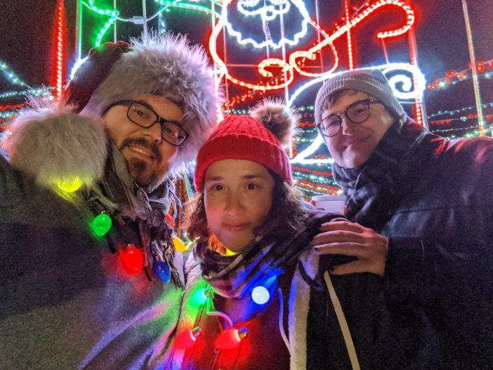 Jonathan and his family at a Christmas light display.