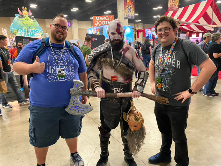 Jonathan and Camden pictured with a cosplay character from God of War.