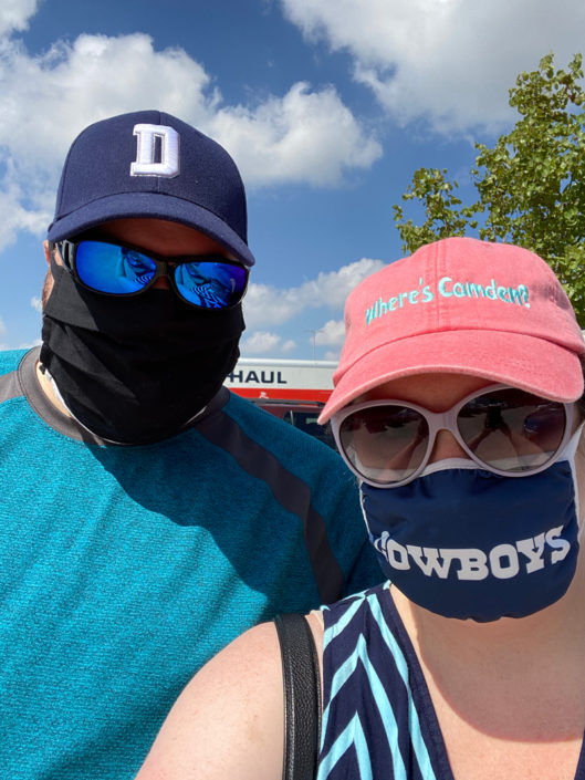 Jonathan and his wife Kelly outdoors wearing masks.