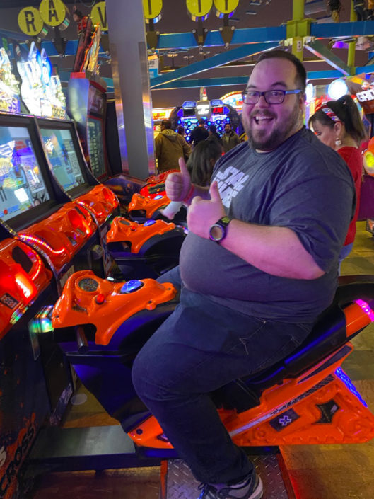 Jonathan riding a motorcycle game at Main Event.