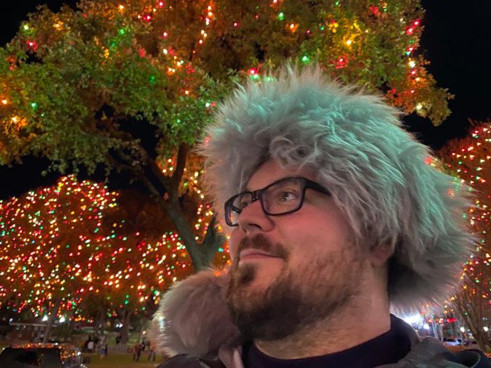 Jonathan in a Santa hat.