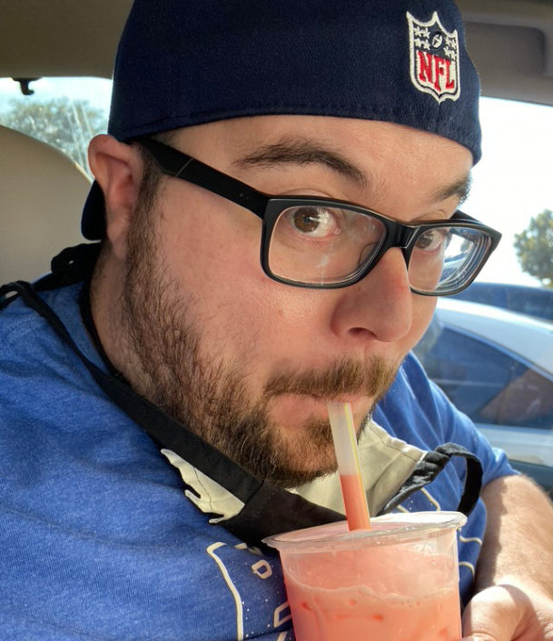 Jonathan sipping on a smoothie