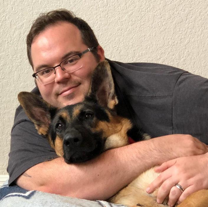 Jonathan and his dog Thorin the German Shepherd.